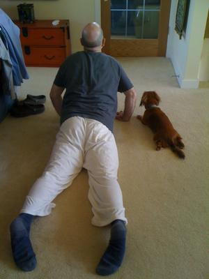 Finn doing yoga with dad